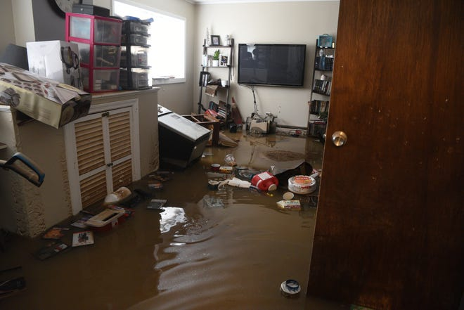 Residents in Little Falls spent Sunday, August 12, 2018 beginning to clean up after flooding of the Peckman River on Saturday evening quickly submerged basements and brought water into some first floors of homes. Dana and Justin Gutschmidt live directly behind the Peckman River. The entire lower level of their home was flooded and they lost two car.