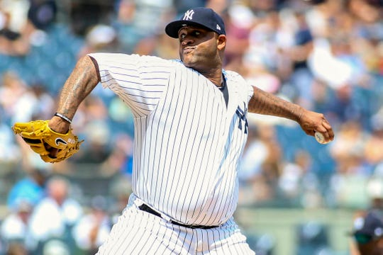 New York Yankees pitcher CC Sabathia (52) pitches in the first inning against the Texas Rangers at Yankee Stadium.