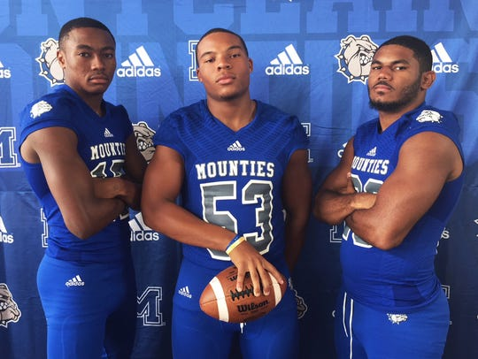Montclair football: (from left) Charles Murphy, Gary Robinson Jr. and Willie Matthews.