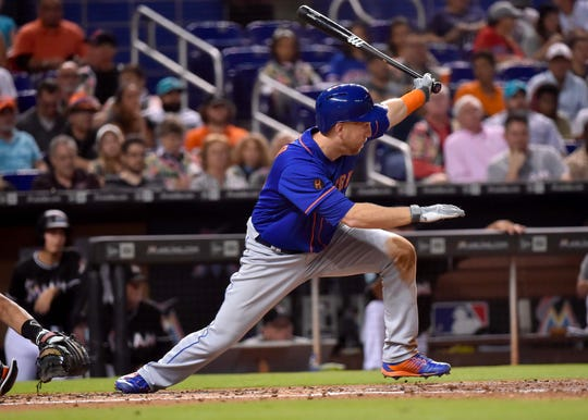 Aug 11, 2018; Miami, FL, USA; New York Mets third baseman Todd Frazier (21) connects for a three run RBI double in the fourth inning against the Miami Marlins at Marlins Park.