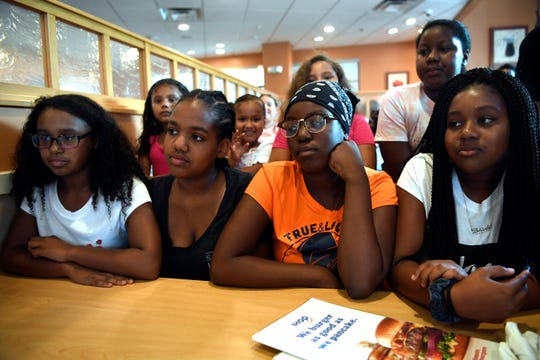 (from left) Kianna Williams, 13, Jayla Bush, 12, Sajadah Tisder, 13, and Kierra Williams, 12, said they were enjoying their day down the shore and had wanted to buy something from the Jenkinson's Aquarium Gift Shop but were asked to leave by an employee. The girls were interviewed at an IHOP in Paterson, NJ on Sunday, August 12, 2018.
