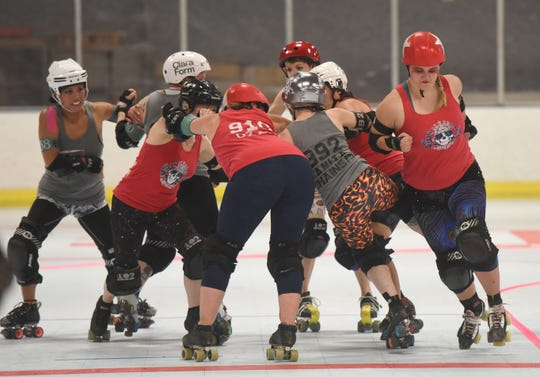 Roller derby match between Gateway Grim Reapers (gray) and Jersey City Bridge and Pummel