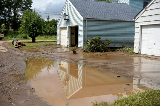 Residents in Little Falls spent Sunday, August 12, 2018 beginning to clean up after flooding of the Peckman River on Saturday evening quickly submerged basements and brought water into some first floors of homes. A layer of mud remains on Cedar St. after the flood waters have receded.