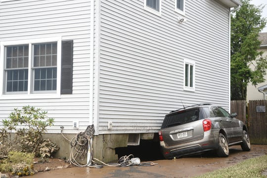 Residents in Little Falls spent Sunday, August 12, 2018 beginning to clean up after flooding of the Peckman River on Saturday evening quickly submerged basements and brought water into some first floors of homes. Cars floated down Harrison St. with one pushing into the foundation of a home.