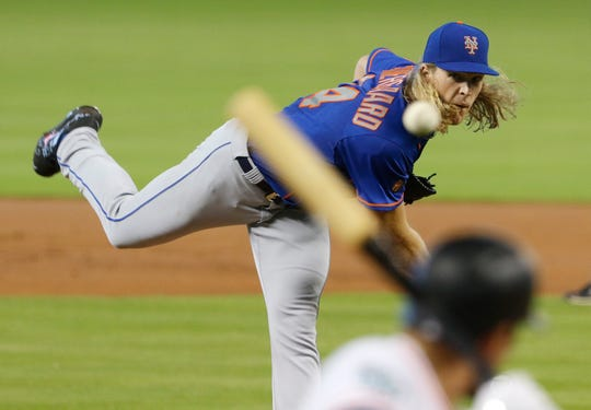 New York Mets starting pitcher Noah Syndergaard throws against the Miami Marlins in the first inning during their baseball game in Miami.