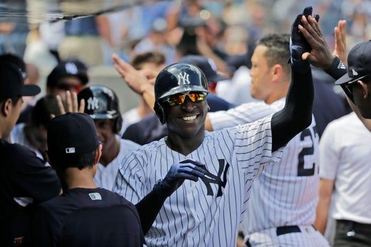 New York Yankees' Didi Gregorius celebrates his two-run home run during the fifth inning.
