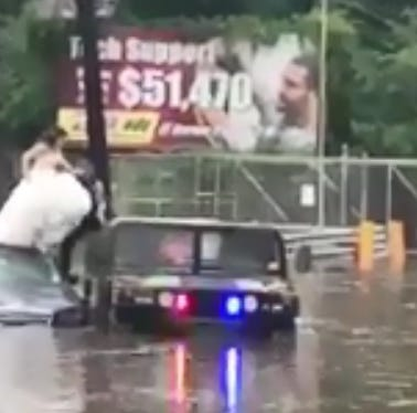 Bogota police rescue bride from flooded car on her wedding day