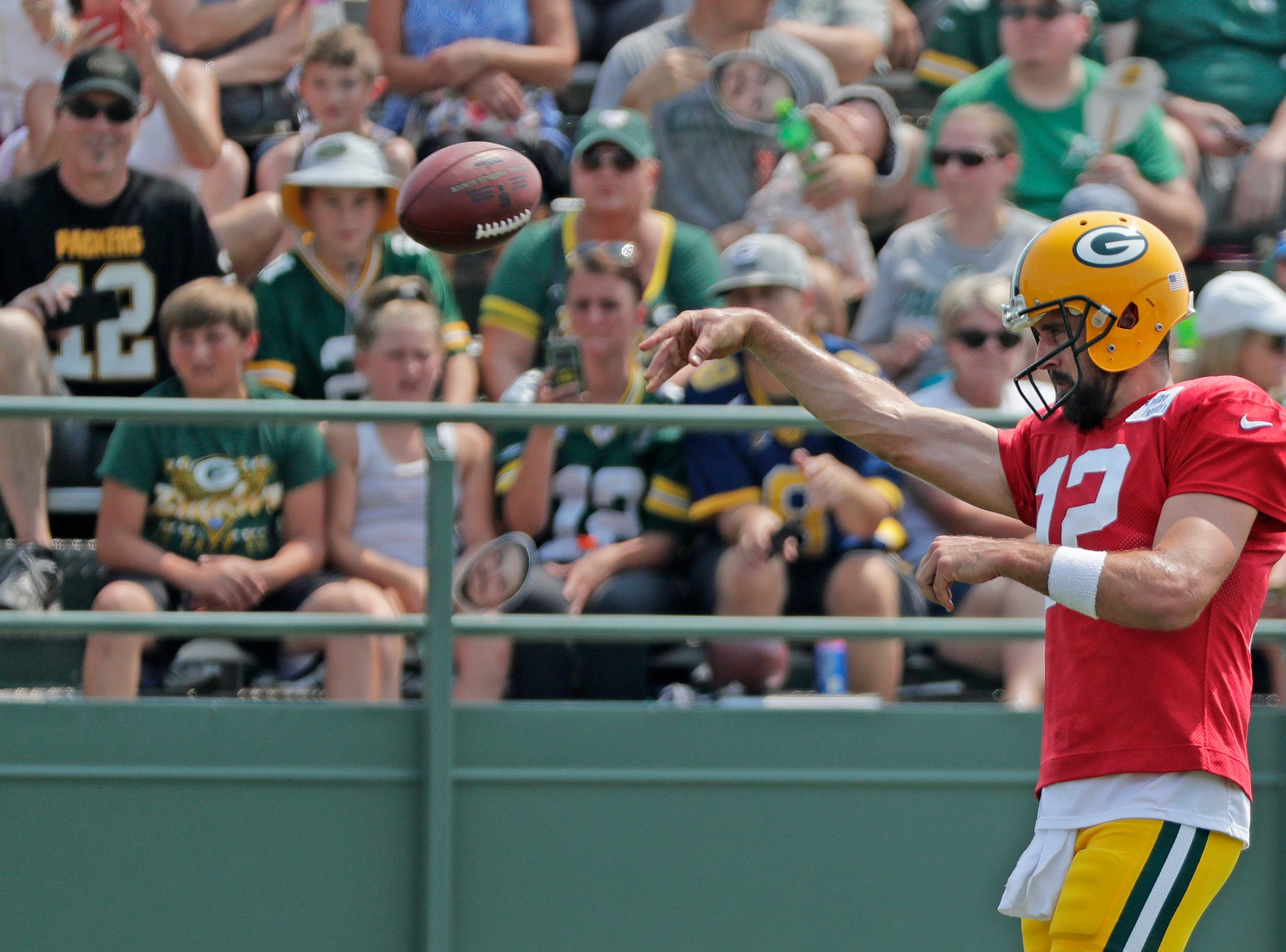 Green Bay Packers quarterback Aaron Rodgers (12) throws during training camp practice at Ray Nitschke Field on Sunday, August 12, 2018 in Ashwaubenon, Wis. 