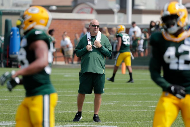 Green Bay Packers defensive coordinator Mike Pettine watches during training camp practice at Ray Nitschke Field on Sunday, August 12, 2018 in Ashwaubenon, Wis. 