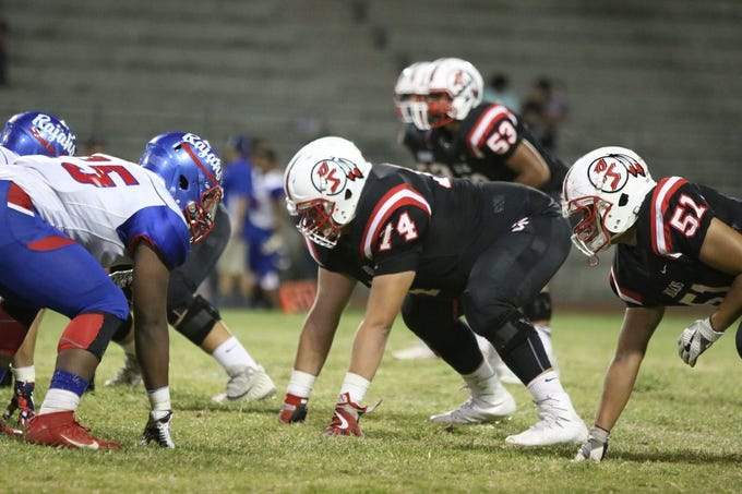 Palm Springs sophomore Julian Polendo lines up for a snap against Indio High School during Friday night?s DVL game. The youngest player on the team, Polendo is 6-foot-5 and 340 pounds  Photos by Taya Gray/Special to The Desert Sun 09/22/17 Taya Gray, Special to The Desert Sun Palm Springs' host Indio in their first DVL game of the season in Palm Springs on Friday, September 22, 2017.