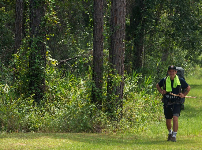 Ed Brown takes in nature while hiking Saturday, August 11, 2018 at Blackwater River State Park.