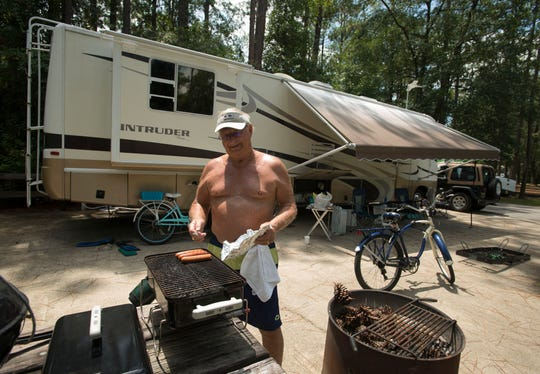 Pat Henagan cooks up some lunch Saturday, August 11, 2018, while camping at Blackwater River State Park.