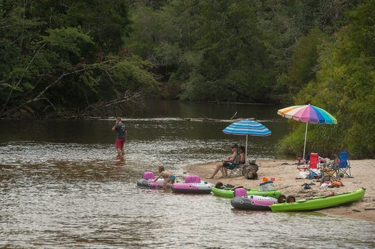 Visitors hang out on the river Saturday, August 11, 2018 at Blackwater River State Park.