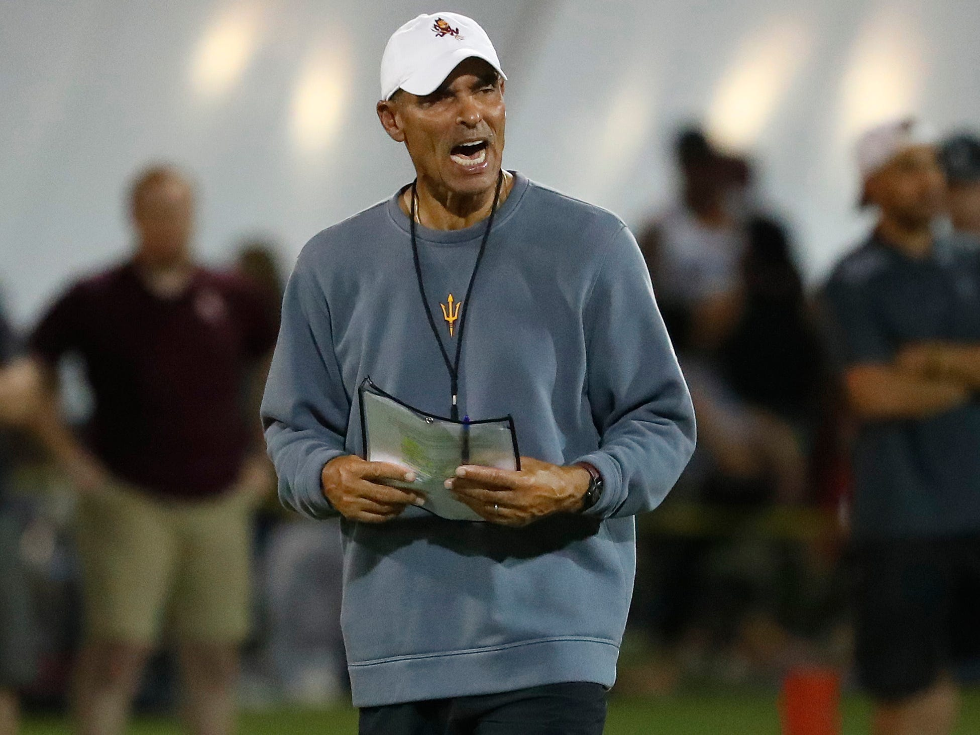 ASU's head coach Herm Edwards instructs his team during the ASU scrimmage at Kajikawa Practice Fields in Tempe, Ariz. on Aug. 11, 2018.