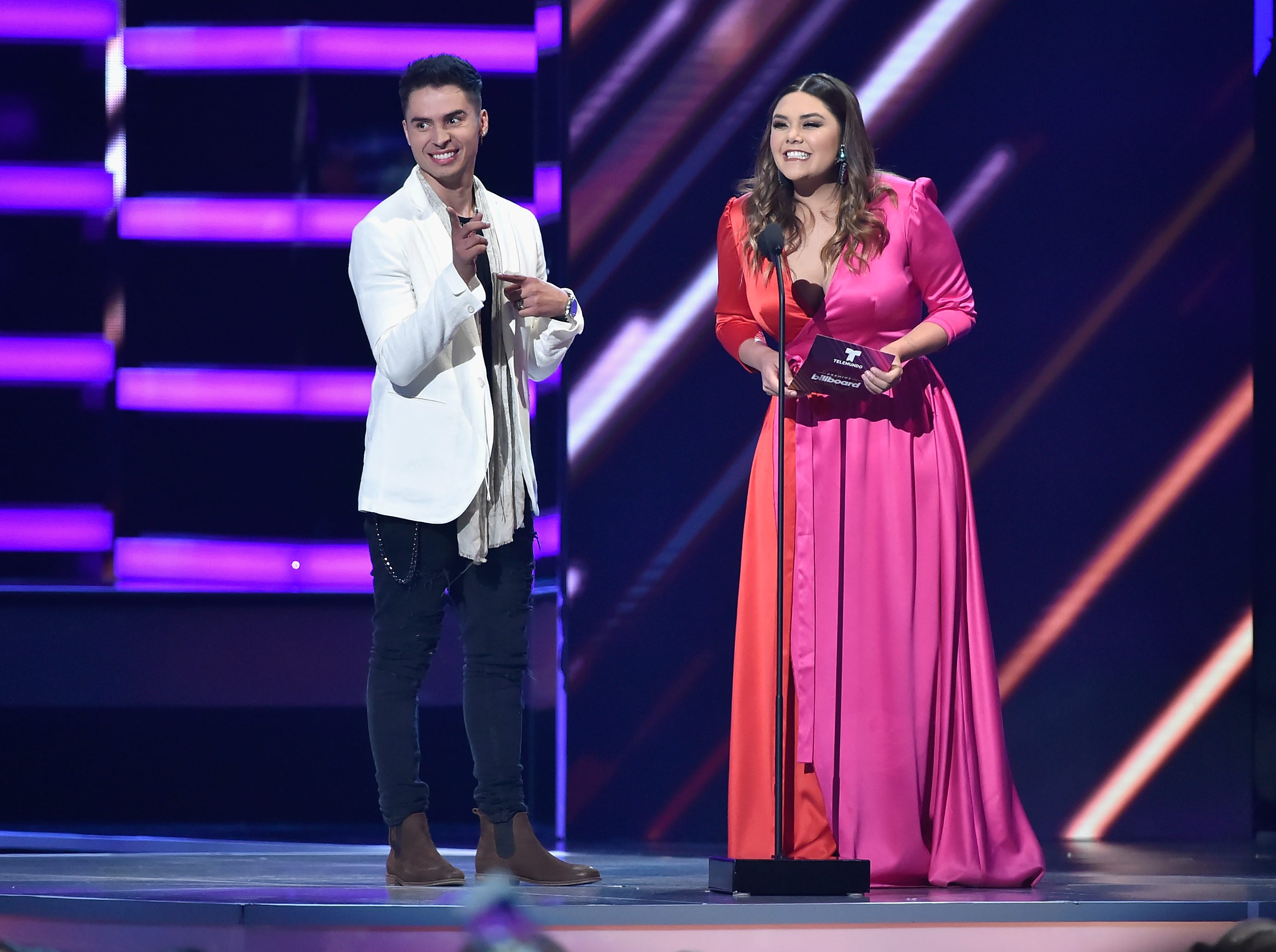 Reykon and Yuridia present an award during the 2018 Billboard Latin Music Awards on April 26, 2018, in Las Vegas.