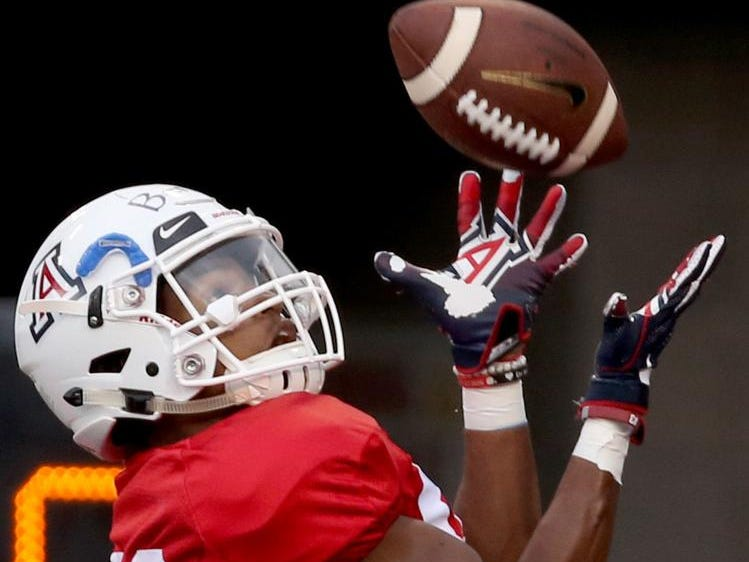 Receiver Stanley Berryhill III cradles a toss into the corner the end zone as the offensive unit runs through drills while the University of Arizona continues preparing for the upcoming season, Friday, August 10, 2018, Tucson, Ariz.