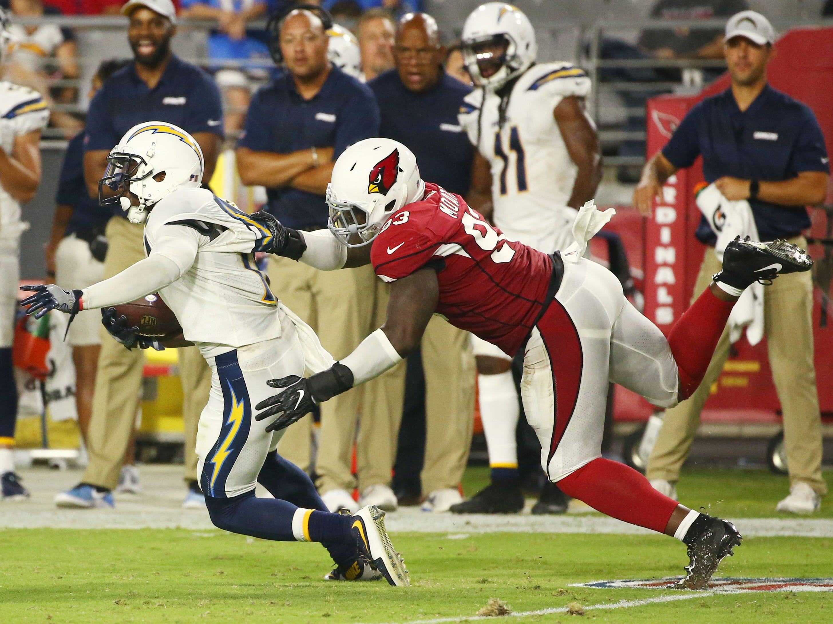 Arizona Cardinals Arthur Moats tackles L.A. Chargers Artavis Scott in the second half during a preseason NFL football game on Aug. 11, 2018 at University of Phoenix Stadium in Glendale, Ariz.