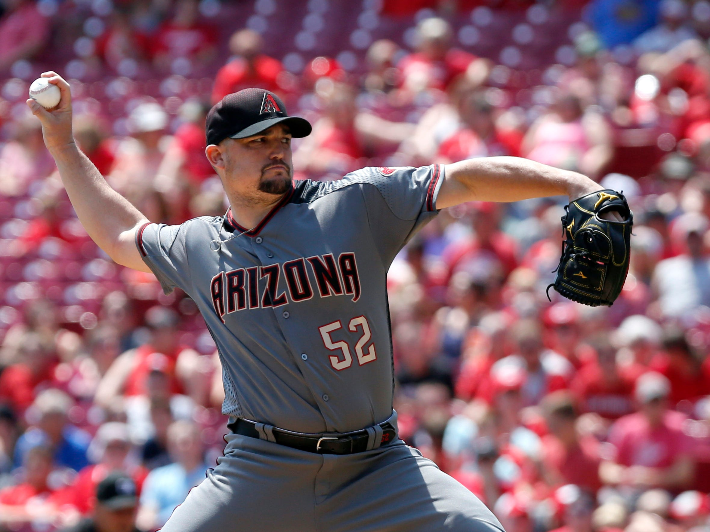 Aug 12, 2018; Cincinnati, OH, USA; Arizona Diamondbacks starting pitcher Zack Godley (52) throws against the Cincinnati Reds during the first inning at Great American Ball Park. Mandatory Credit: David Kohl-USA TODAY Sports