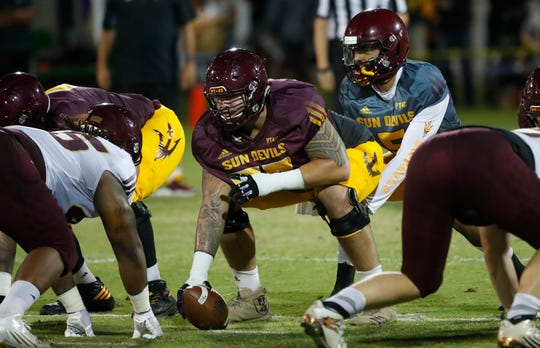 ASU's Manny Wilkins takes under center from Cohl Cabral (73) during the ASU scrimmage at Kajikawa Practice Fields in Tempe, Ariz. on Aug. 11, 2018.