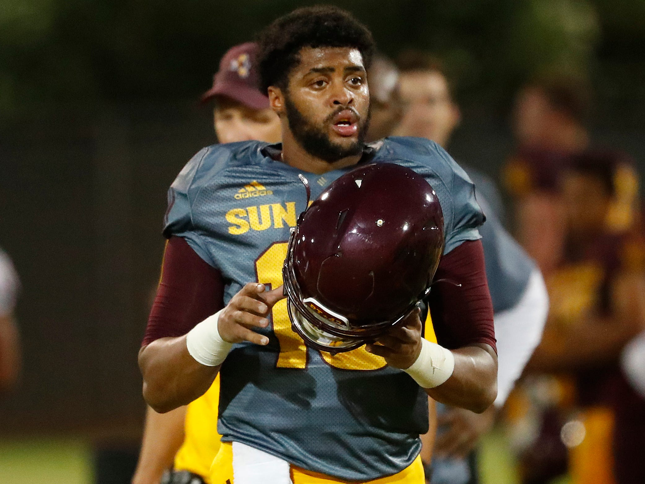 ASU's Dillon Sterling-Cole (15) puts his helmet on during the ASU scrimmage at Kajikawa Practice Fields in Tempe, Ariz. on Aug. 11, 2018.
