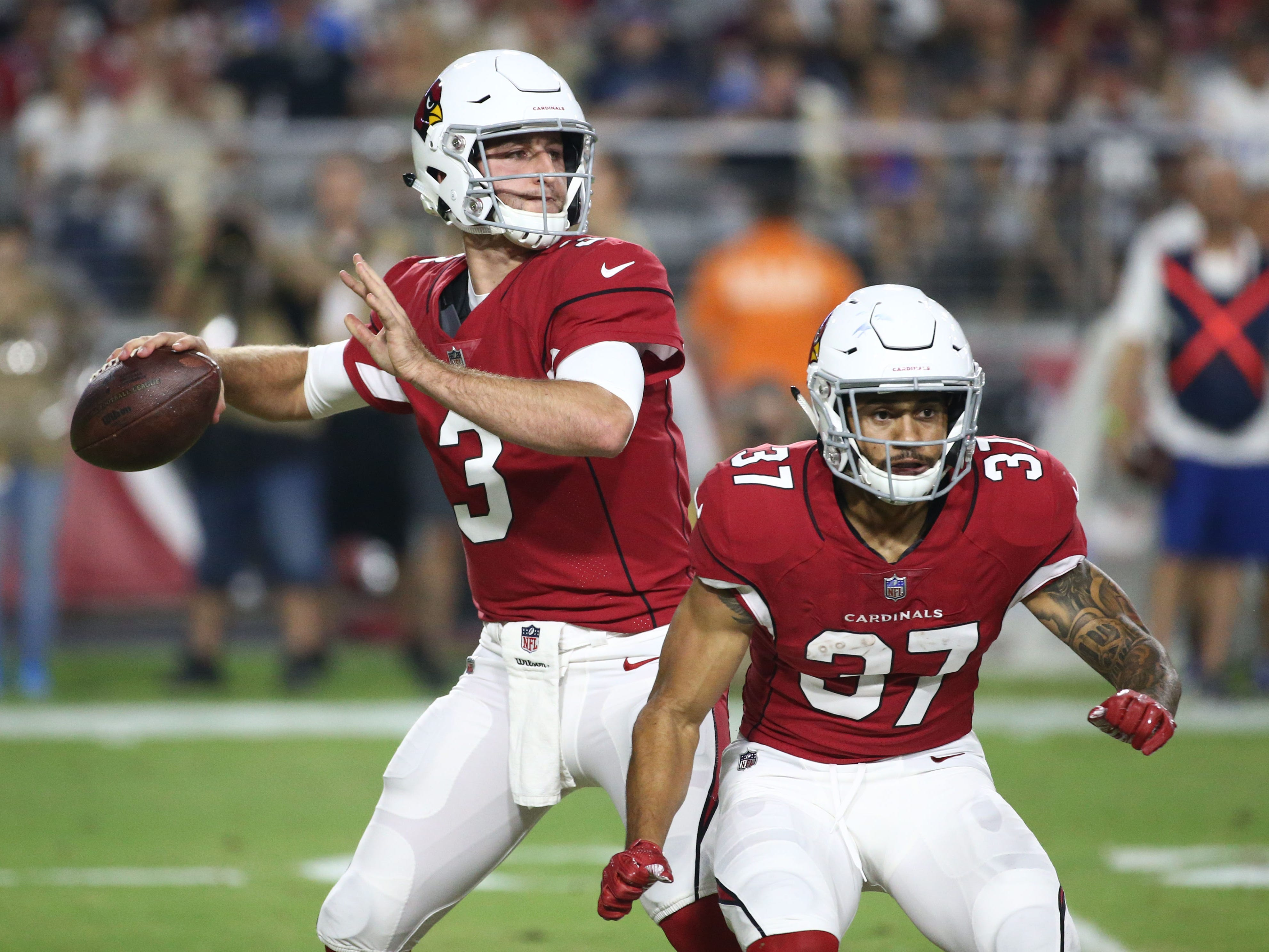 Arizona Cardinals quarterback Josh Rosen completes his first pass against the L.A. Chargers in the first half during a preseason NFL football game on Aug. 11, 2018 at University of Phoenix Stadium in Glendale, Ariz.