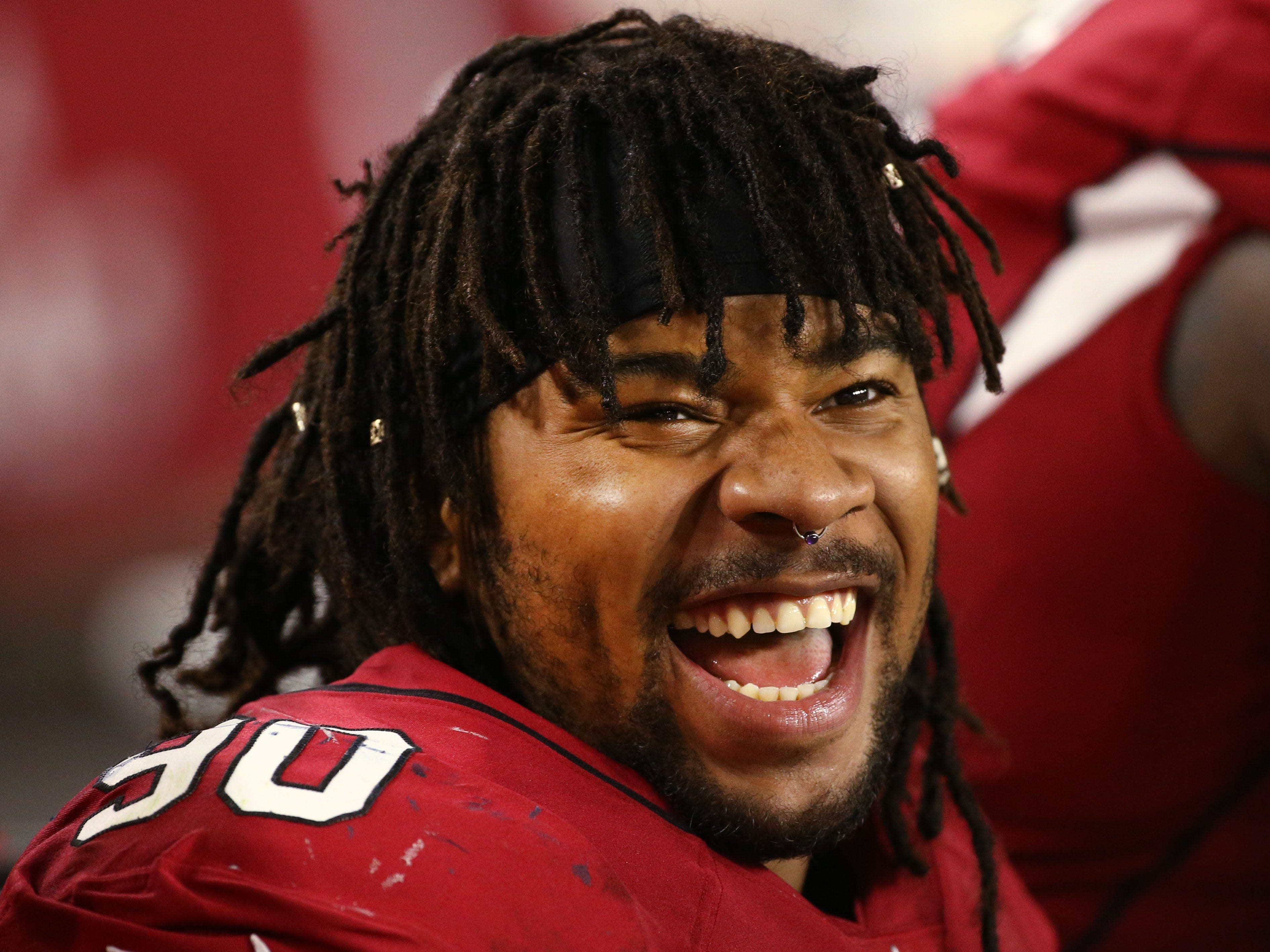 Arizona Cardinals Robert Nkemdiche sings on the sidelines against the L.A. Chargers in the first half during a preseason NFL football game on Aug. 11, 2018 at University of Phoenix Stadium in Glendale, Ariz.