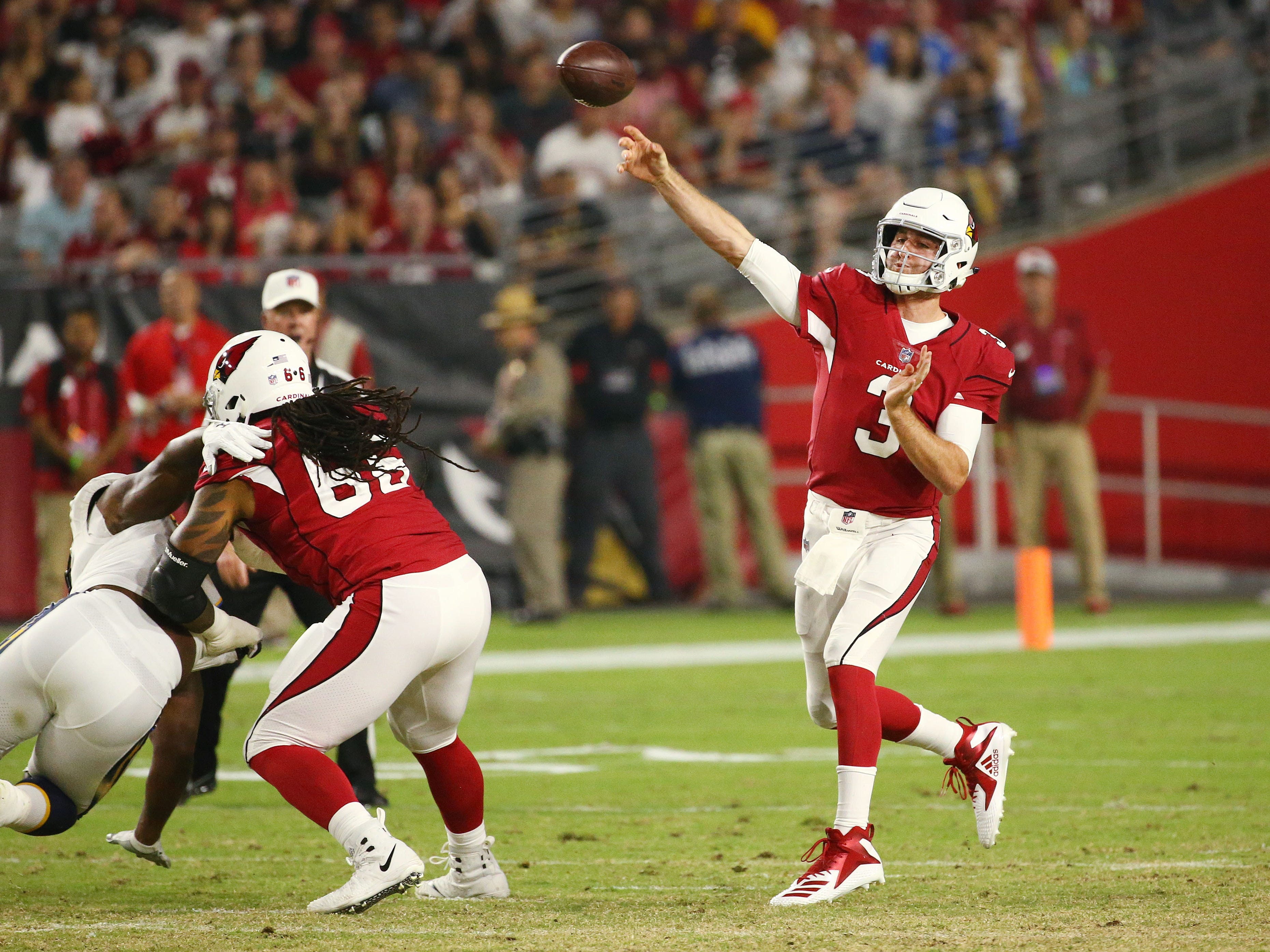 Arizona Cardinals quarterback Josh Rosen completes a pass against the L.A. Chargers in the first half during a preseason NFL football game on Aug. 11, 2018 at University of Phoenix Stadium in Glendale, Ariz.