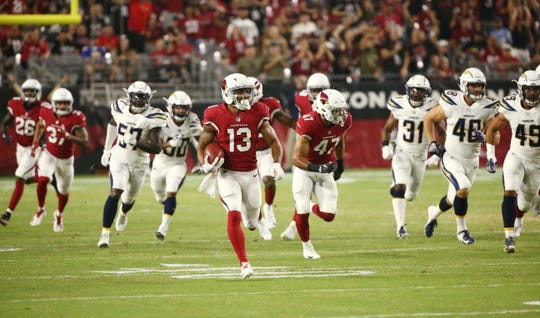 Christian Kirk returns a punt against the L.A. Chargers in the first half during a preseason NFL football game on Aug. 11, 2018 at University of Phoenix Stadium in Glendale, Ariz.