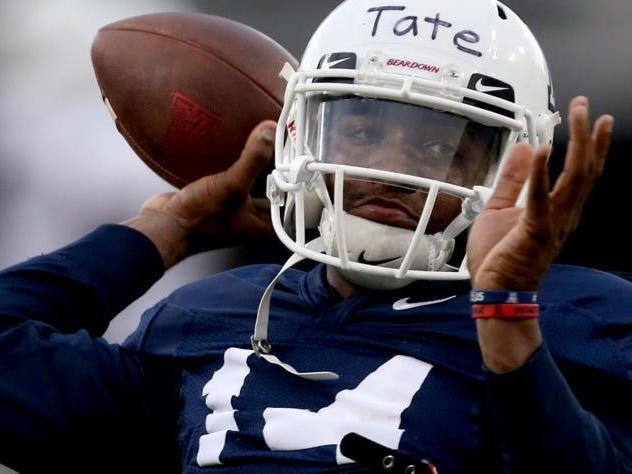 Quarterback Khalil Tate rears back to fire a pass as the University of Arizona continues preparing for the upcoming season, Friday, August 10, 2018, Tucson, Ariz.