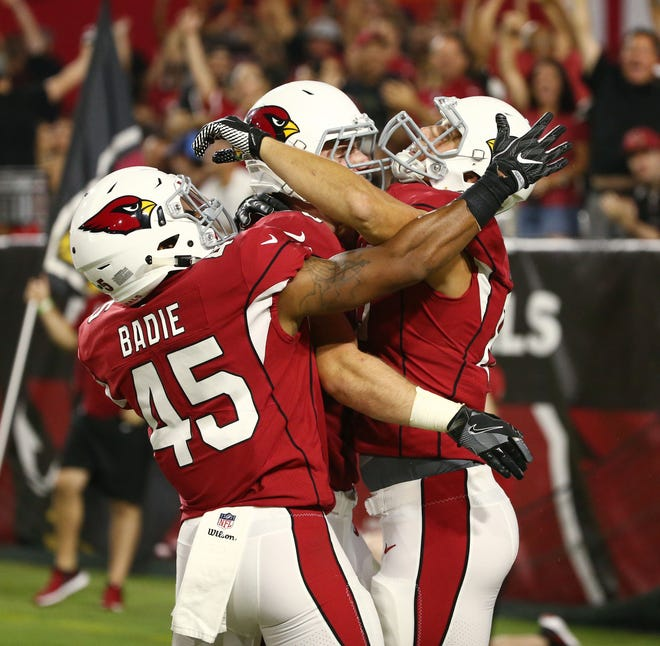 Arizona Cardinals Bryce Williams (80, right) celebrates his touchdown catch against the L.A. Chargers in the second half during a preseason NFL football game on Aug. 11, 2018 at University of Phoenix Stadium in Glendale, Ariz.