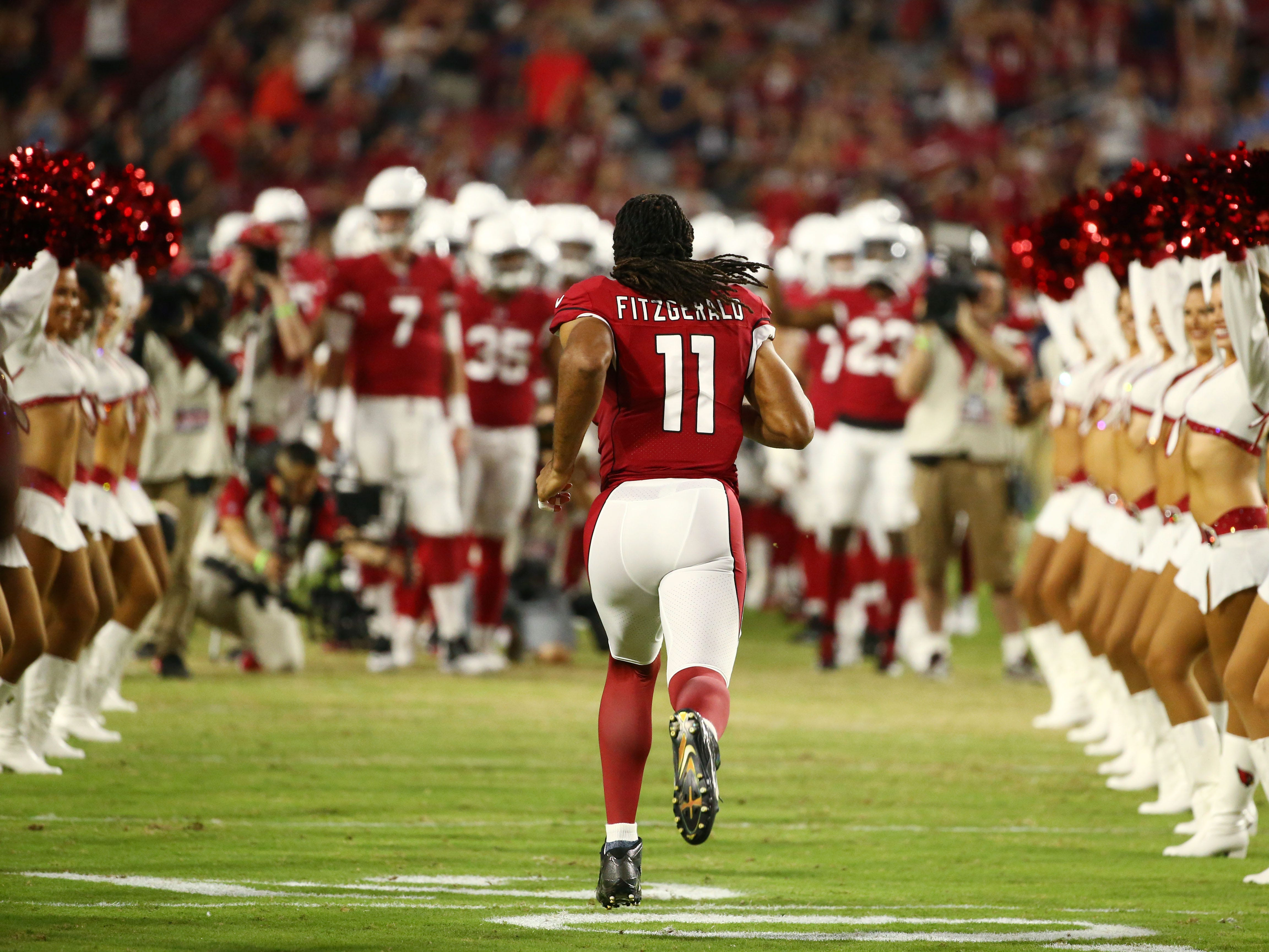 Arizona Cardinals Larry Fitzgerald takes the field against the L.A. Chargers in the first half during a preseason NFL football game on Aug. 11, 2018 at University of Phoenix Stadium in Glendale, Ariz.