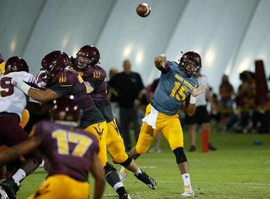 ASU's Dillon Sterling-Cole (15) throws a pass during the ASU scrimmage at Kajikawa Practice Fields in Tempe, Ariz. on Aug. 11, 2018.