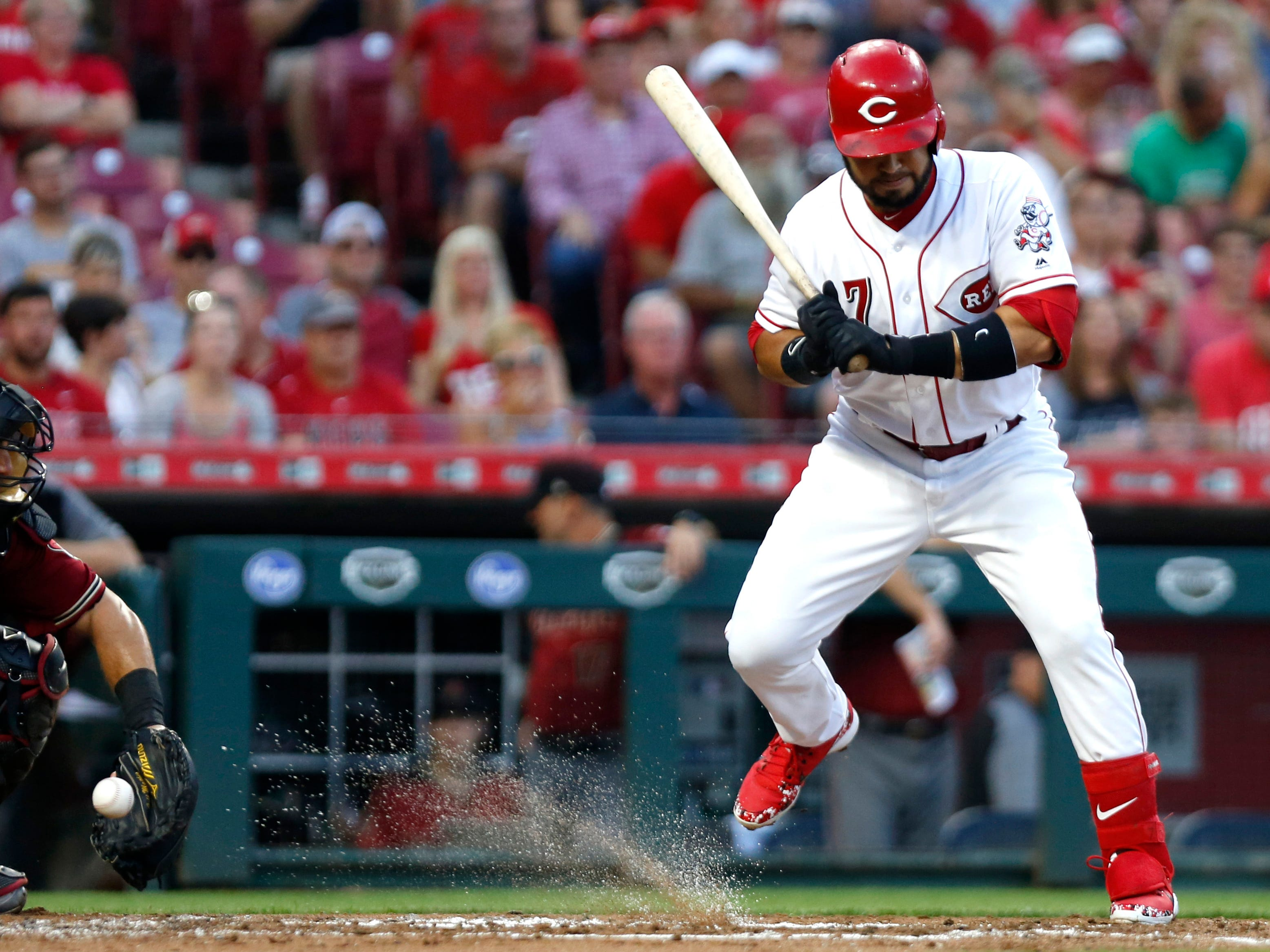 Aug 11, 2018; Cincinnati, OH, USA; Cincinnati Reds third baseman Eugenio Suarez (7) moves away from a pitch against the Arizona Diamondbacks during the first inning at Great American Ball Park. Mandatory Credit: David Kohl-USA TODAY Sports