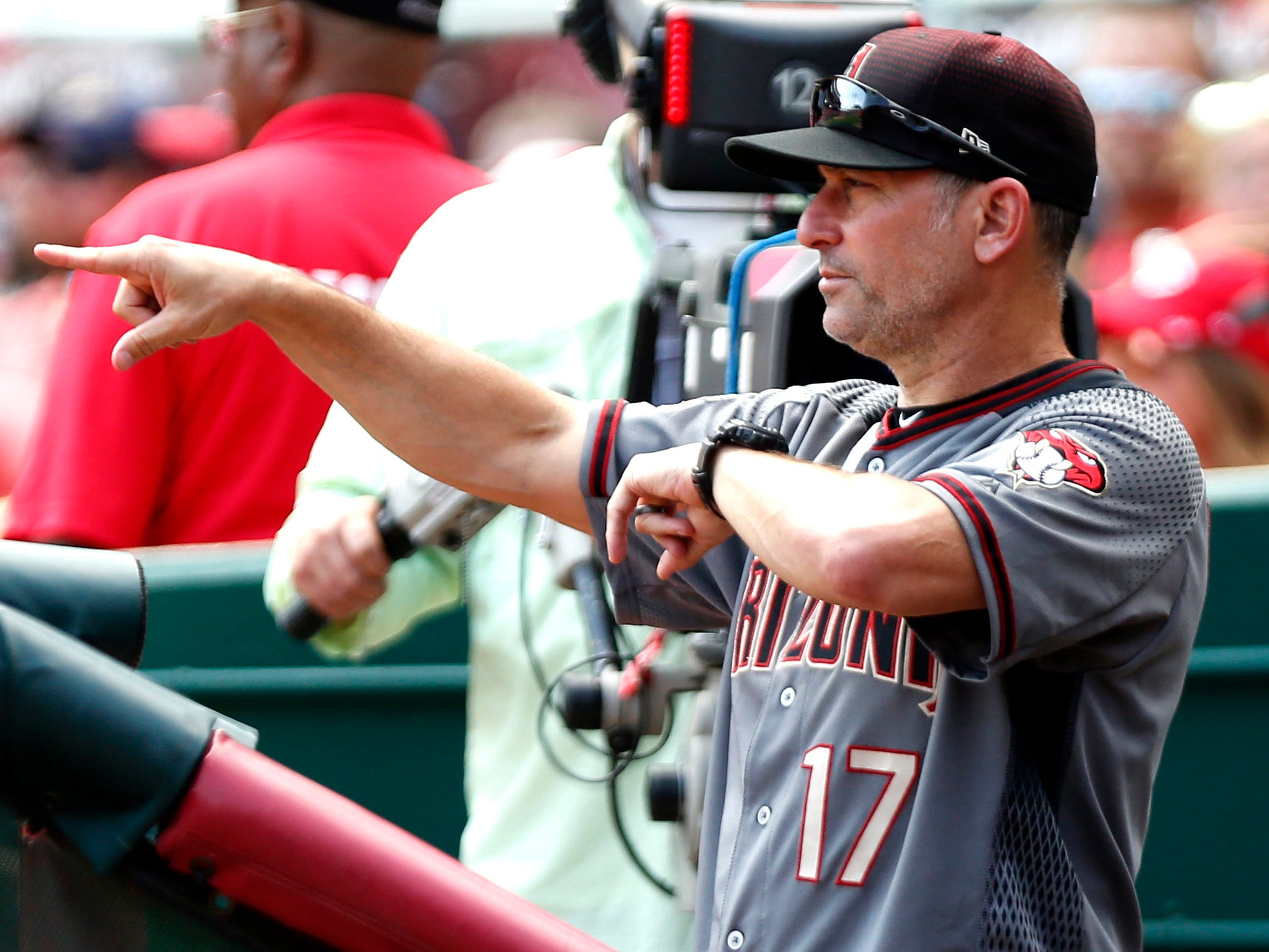Aug 12, 2018; Cincinnati, OH, USA; Arizona Diamondbacks manager Torey Lovullo (17) signals from the dugout during a game against the Cincinnati Reds at Great American Ball Park. Mandatory Credit: David Kohl-USA TODAY Sports
