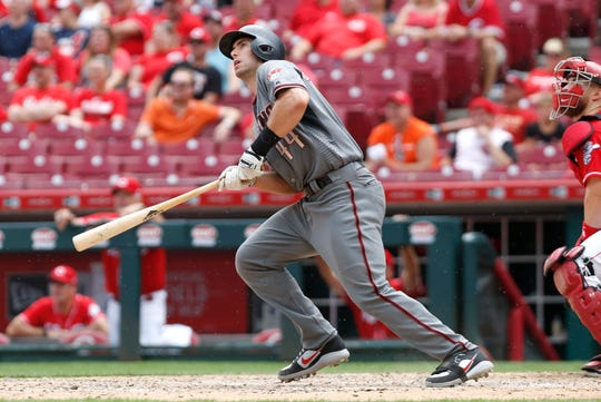 Diamondbacks first baseman Paul Goldschmidt hits a solo home run against the Reds during the ninth inning of a game Aug. 12 at the Great American Ball Park.