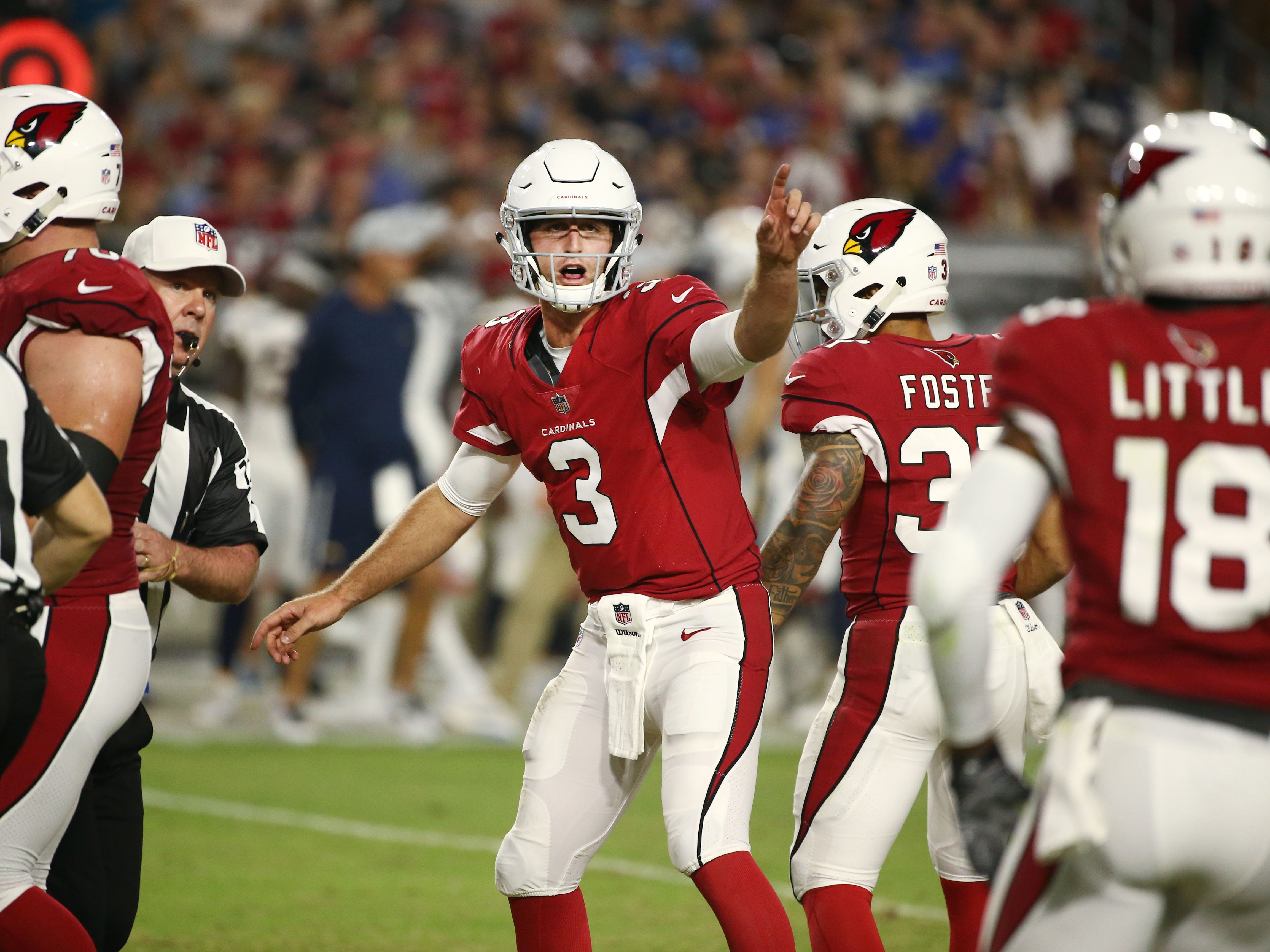 Arizona Cardinals Josh Rosen tries to hurry a play against the L.A. Chargers in the first half during a preseason NFL football game on Aug. 11, 2018 at University of Phoenix Stadium in Glendale, Ariz.