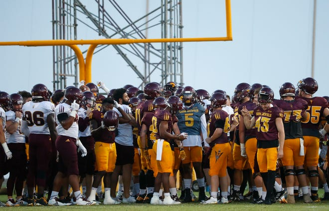 ASU's Manny Wilkins (5) brings the team in at the start during the ASU scrimmage at Kajikawa Practice Fields in Tempe, Ariz. on Aug. 11, 2018.