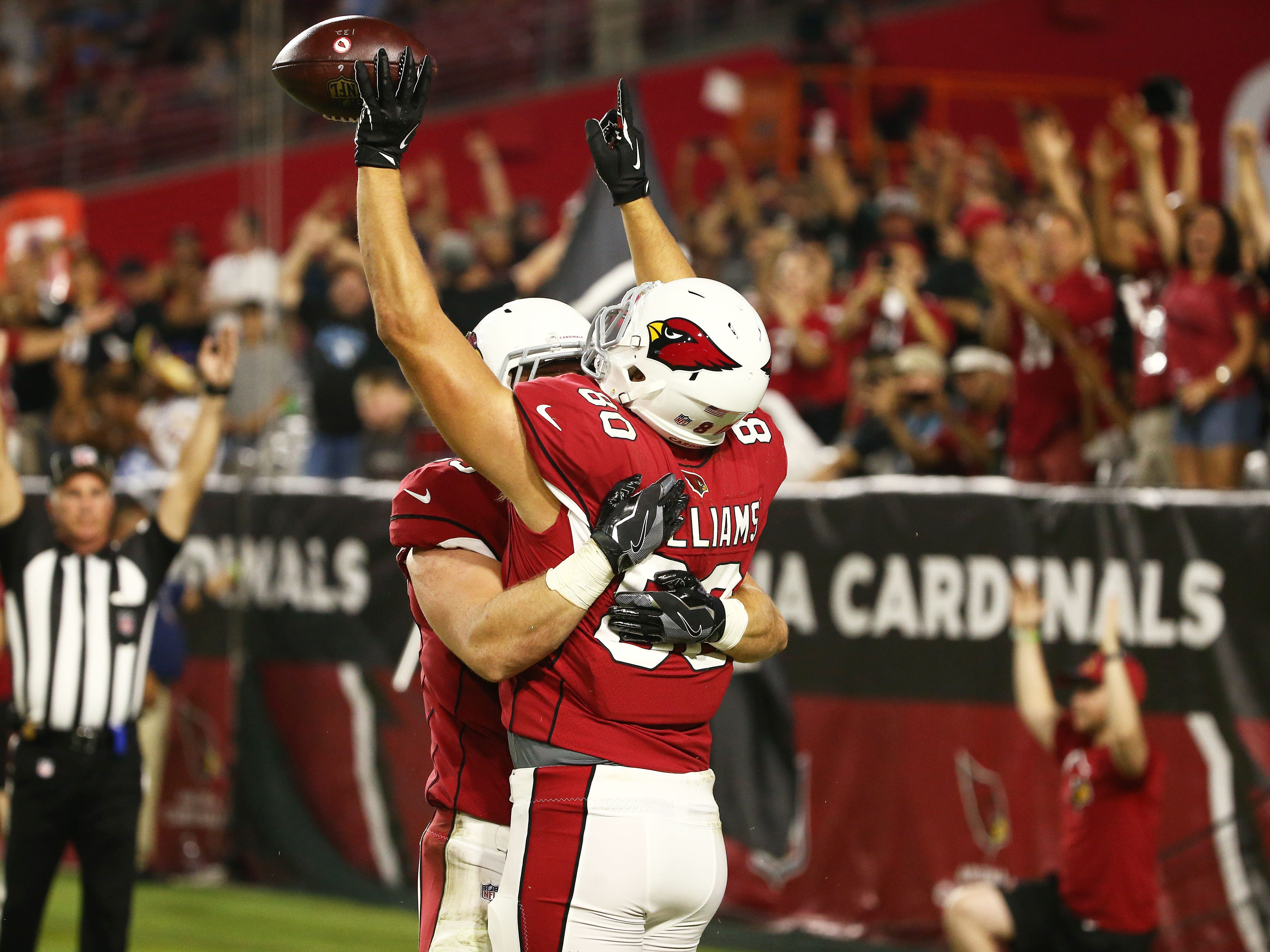 Arizona Cardinals Bryce Williams (80) celebrates his touchdown catch against the L.A. Chargers in the second half during a preseason NFL football game on Aug. 11, 2018 at University of Phoenix Stadium in Glendale, Ariz.