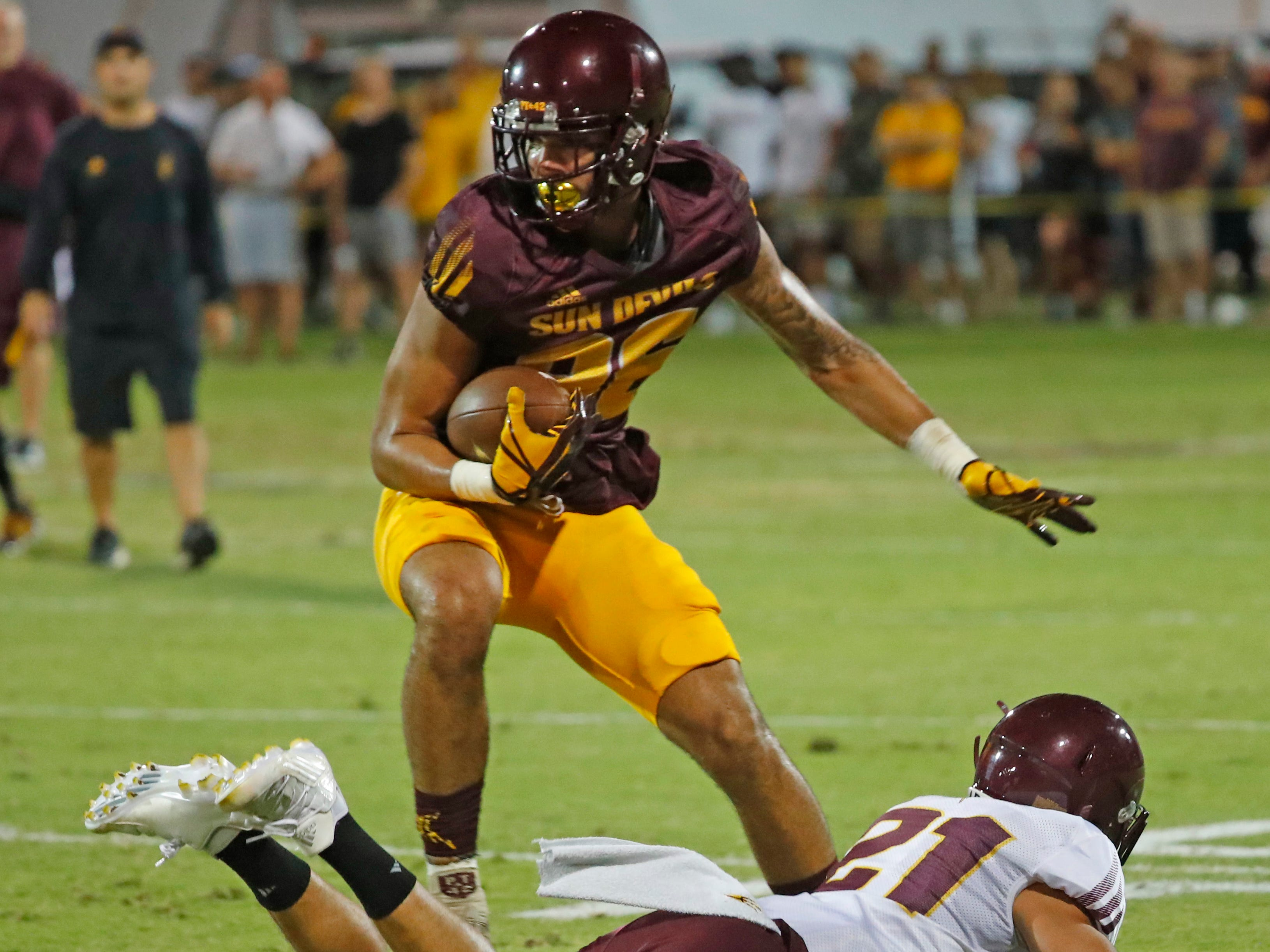 ASU's Curtis Hodges (86) makes a catch and breaks a tackle from Terin Adams (21) during the ASU scrimmage at Kajikawa Practice Fields in Tempe, Ariz. on Aug. 11, 2018.
