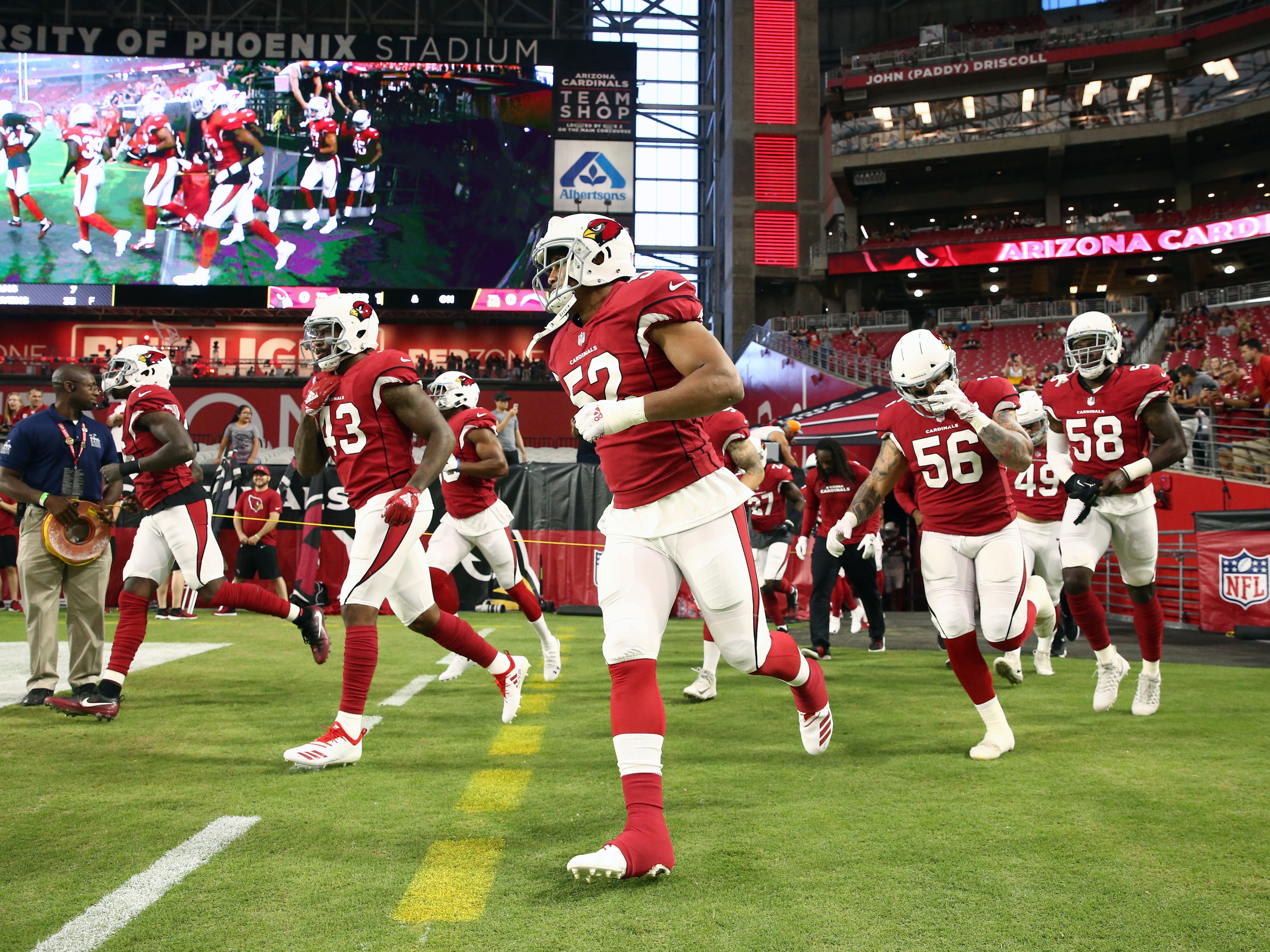Arizona Cardinals arrive for pregame warms-up before playing the L.A. Chargers during a preseason NFL football game on Aug. 11, 2018 at University of Phoenix Stadium in Glendale, Ariz.