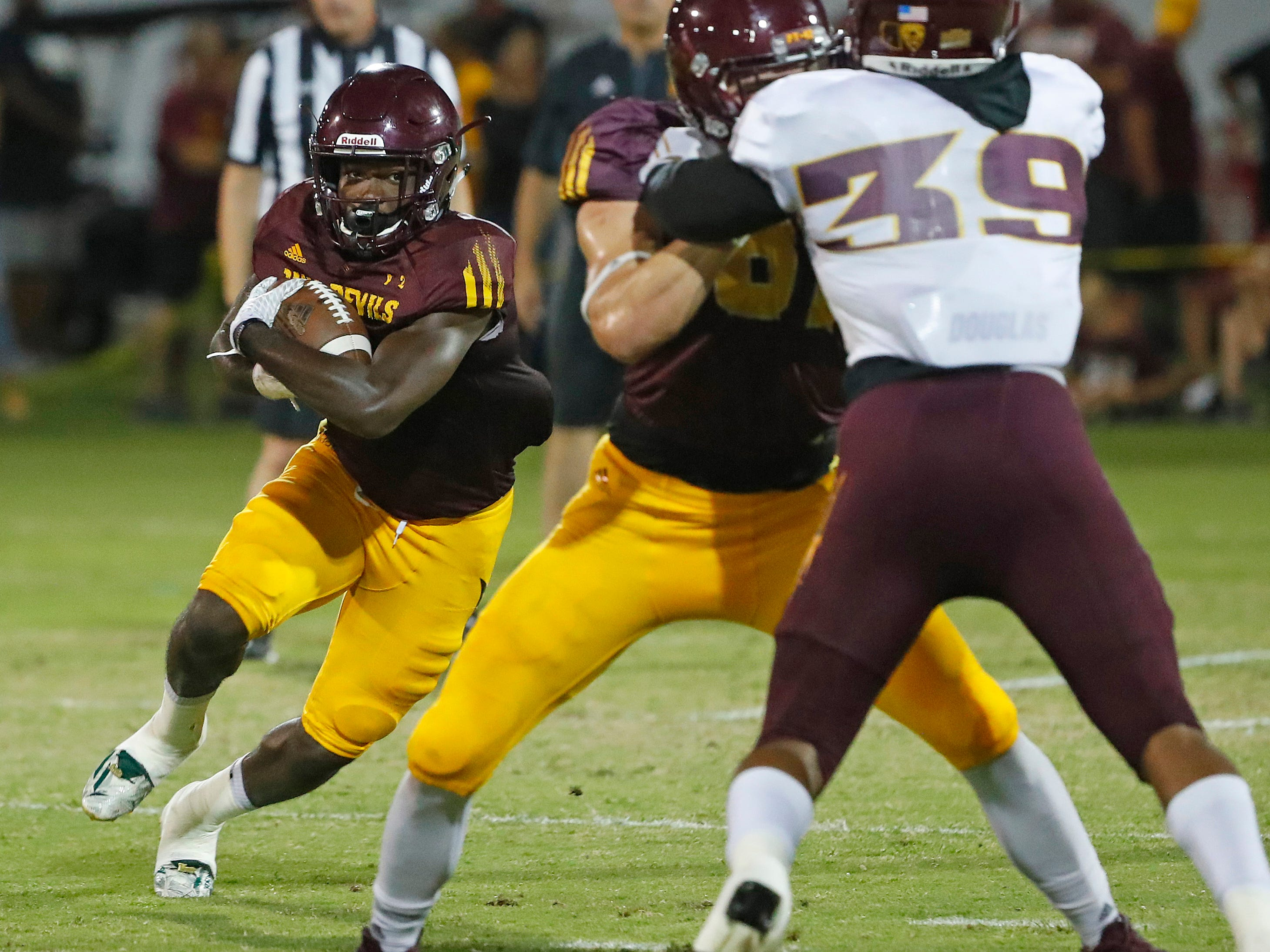ASU's Eno Benjamin (3) runs against the defense during the ASU scrimmage at Kajikawa Practice Fields in Tempe, Ariz. on Aug. 11, 2018.