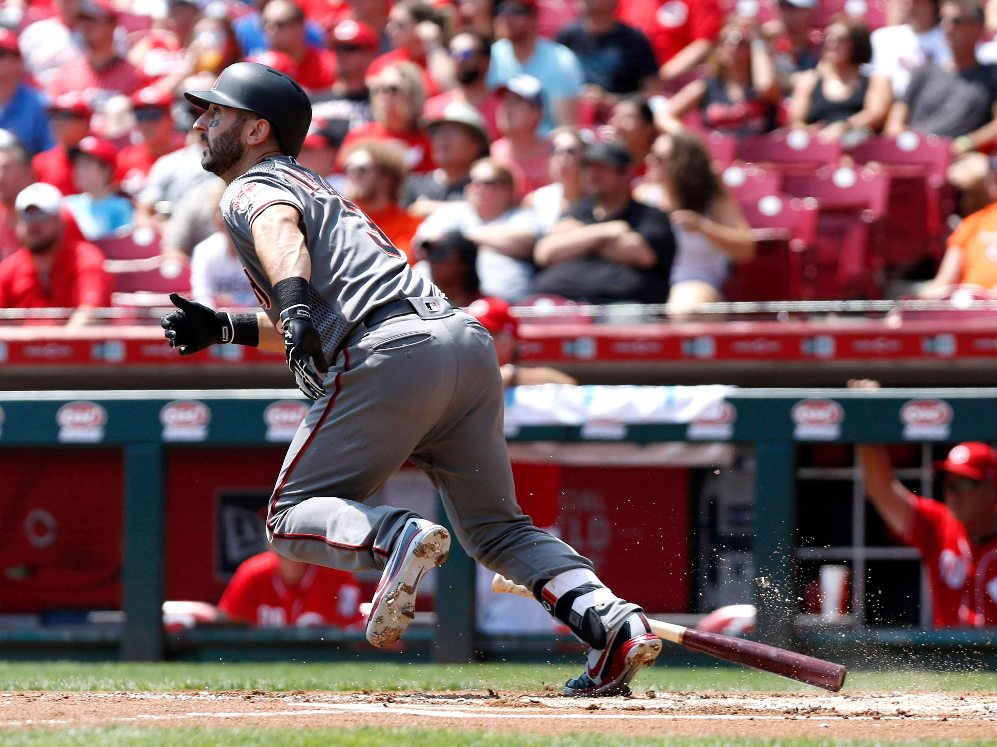 Aug 12, 2018; Cincinnati, OH, USA; Arizona Diamondbacks third baseman Daniel Descalso (3) hits a three-run home run against the Cincinnati Reds during the first inning at Great American Ball Park. Mandatory Credit: David Kohl-USA TODAY Sports