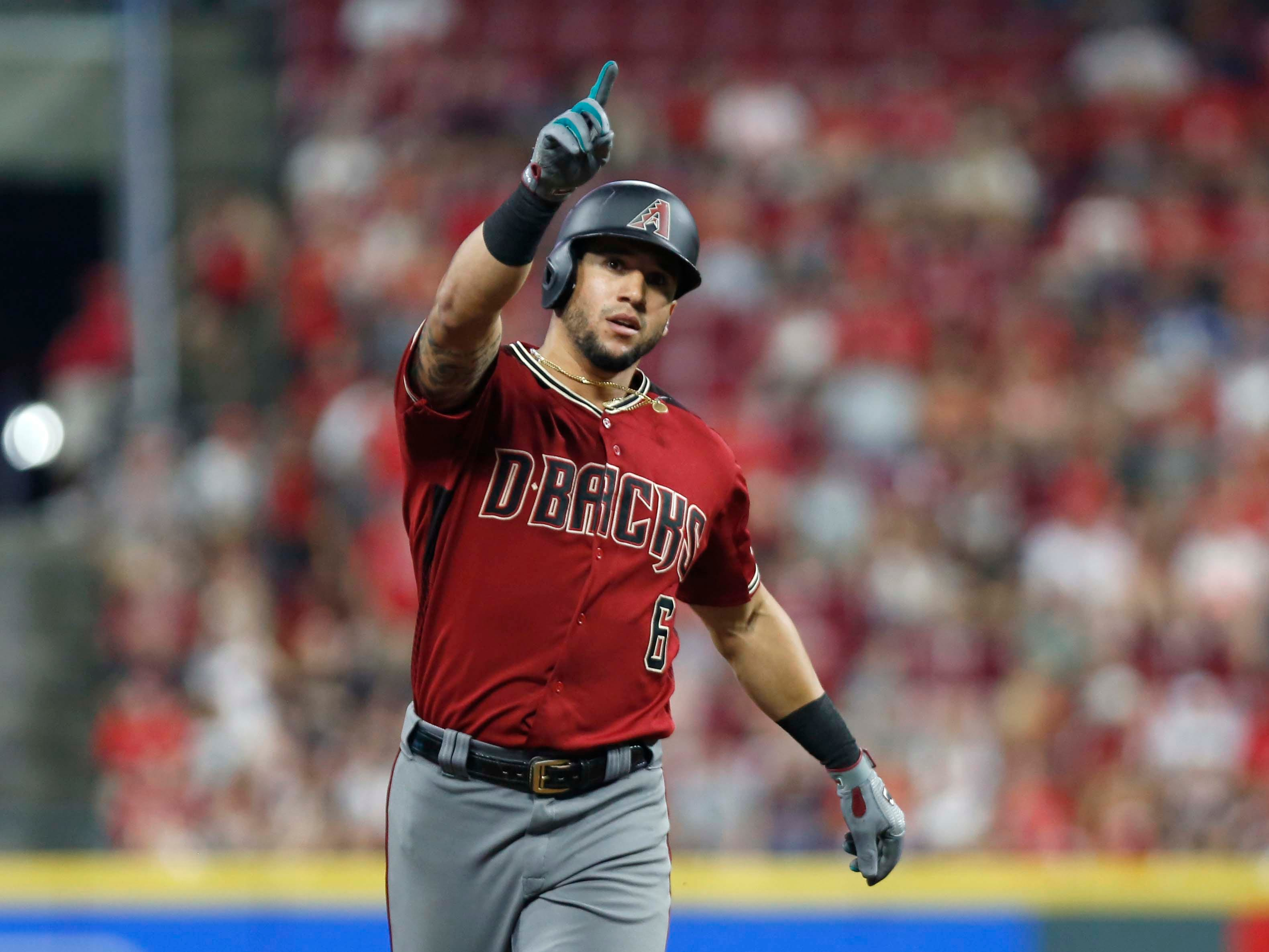Aug 11, 2018; Cincinnati, OH, USA; Arizona Diamondbacks right fielder David Peralta (6) reacts as he rounds the bases after hitting a solo home run against the Cincinnati Reds during the eighth inning at Great American Ball Park. Mandatory Credit: David Kohl-USA TODAY Sports