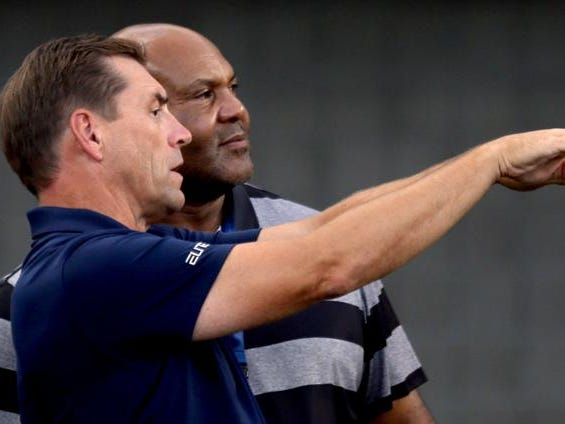 Athletic director Dave Heeke, left, talks about the ongoing renovations at Arizona Stadium with former Wildcat Ricky Hunley as the University of Arizona continues preparing for the upcoming season, Friday, August 10, 2018, Tucson, Ariz.