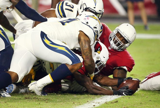 Arizona Cardinals running back Chase Edmonds stretches the ball over the goal line for a touchdown against the L.A. Chargers in the first half during a preseason NFL football game on Aug. 11, 2018 at University of Phoenix Stadium in Glendale, Ariz.