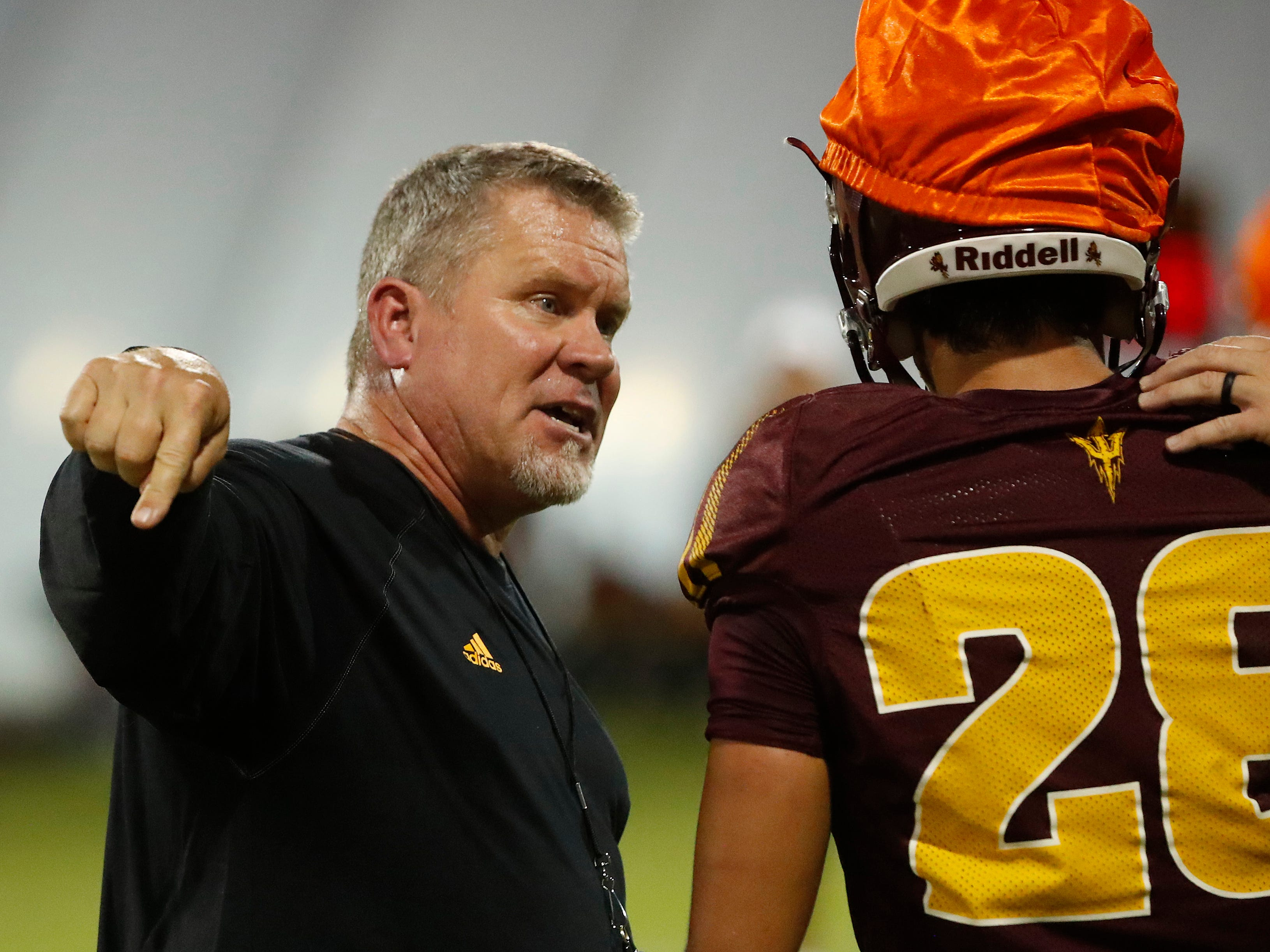 ASU's special teams coordinator Shawn Slocum yells at Angel Ruiz (28) during the ASU scrimmage at Kajikawa Practice Fields in Tempe, Ariz. on Aug. 11, 2018.