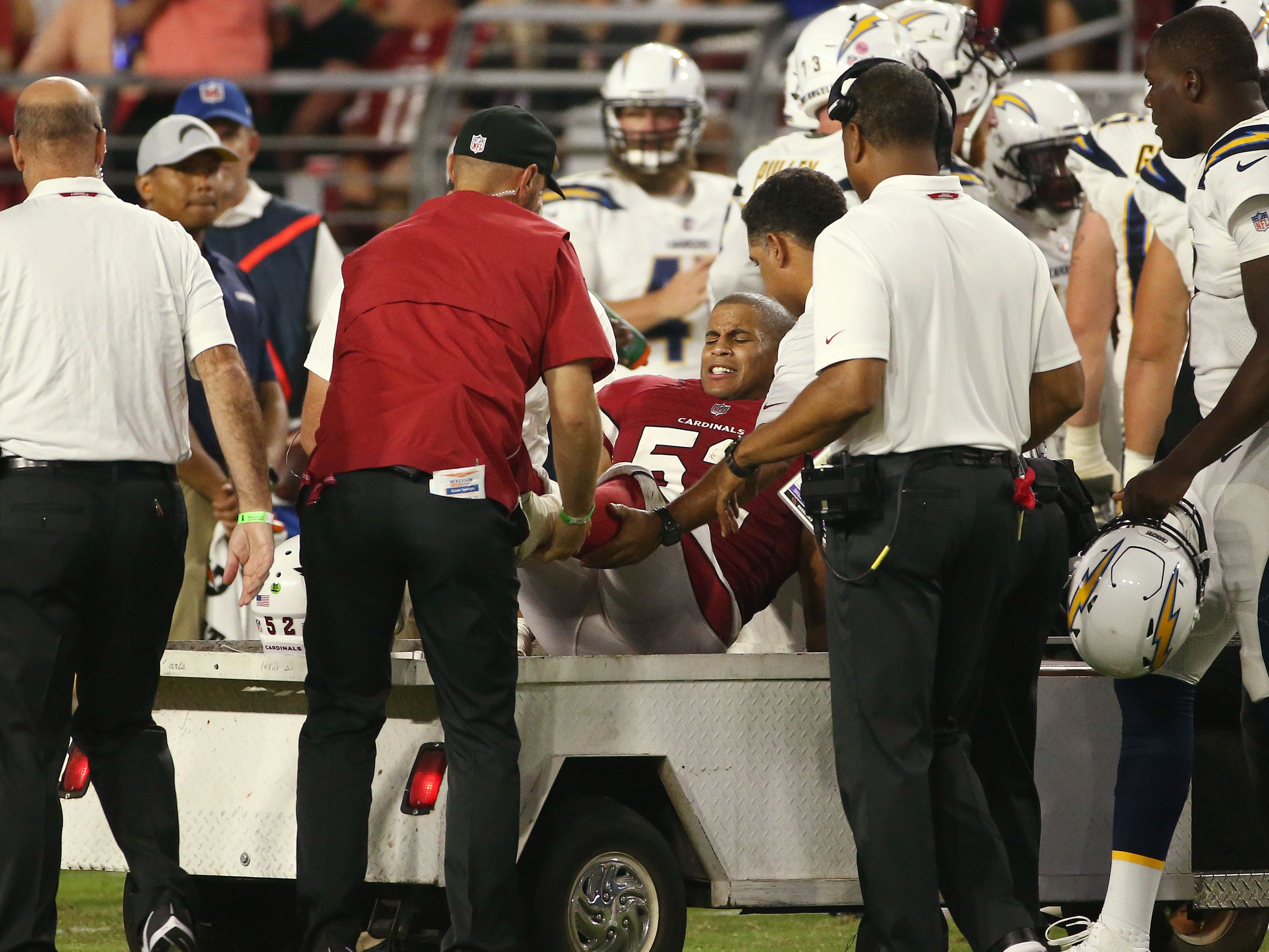 Arizona Cardinals linebacker Jeremy Cash is carted off the field after an injury against the L.A. Chargers in the second half during a preseason NFL football game on Aug. 11, 2018 at University of Phoenix Stadium in Glendale, Ariz.