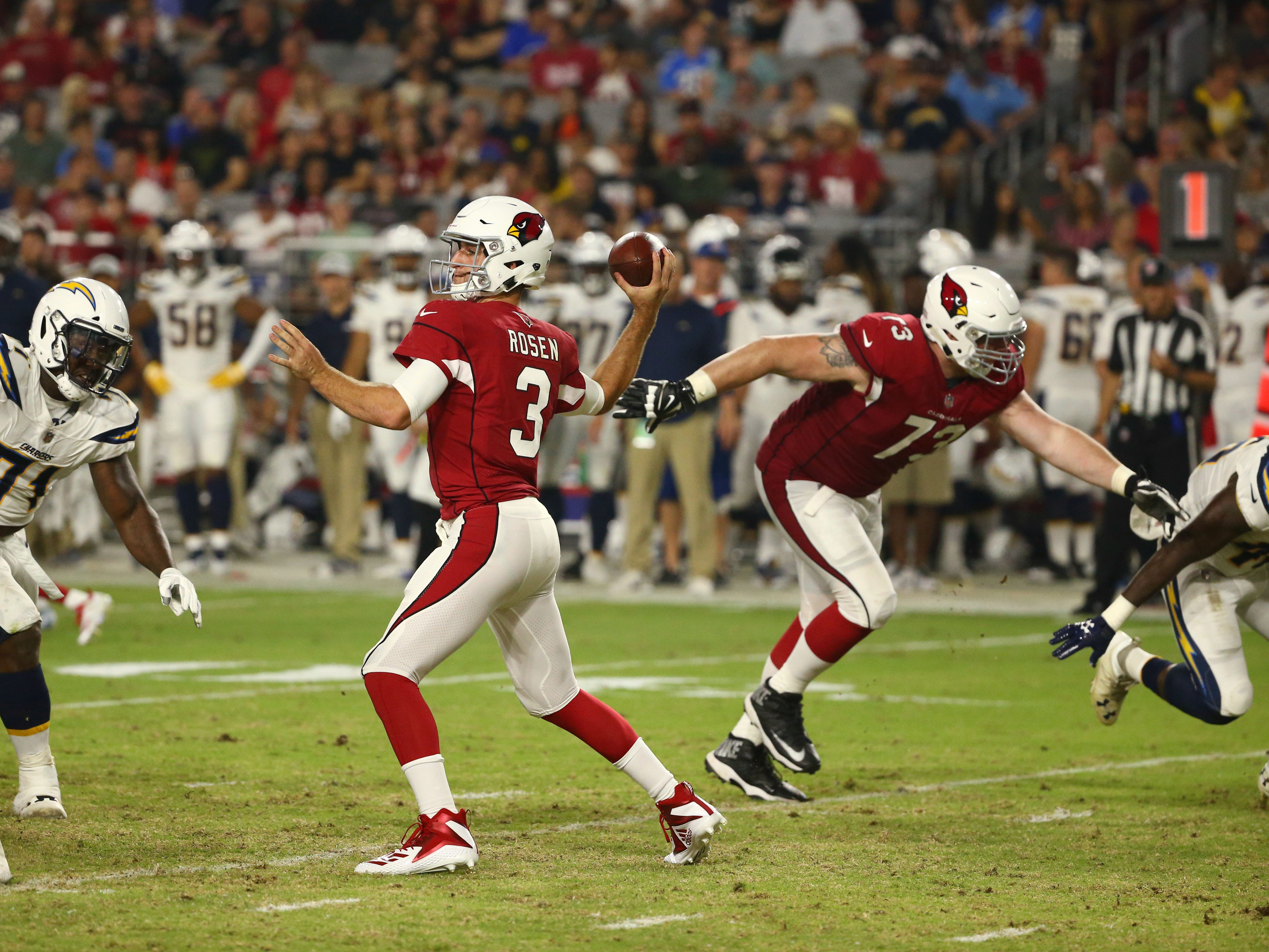 Arizona Cardinals Josh Rosen throw a pass against the L.A. Chargers in the first half during a preseason NFL football game on Aug. 11, 2018 at University of Phoenix Stadium in Glendale, Ariz.