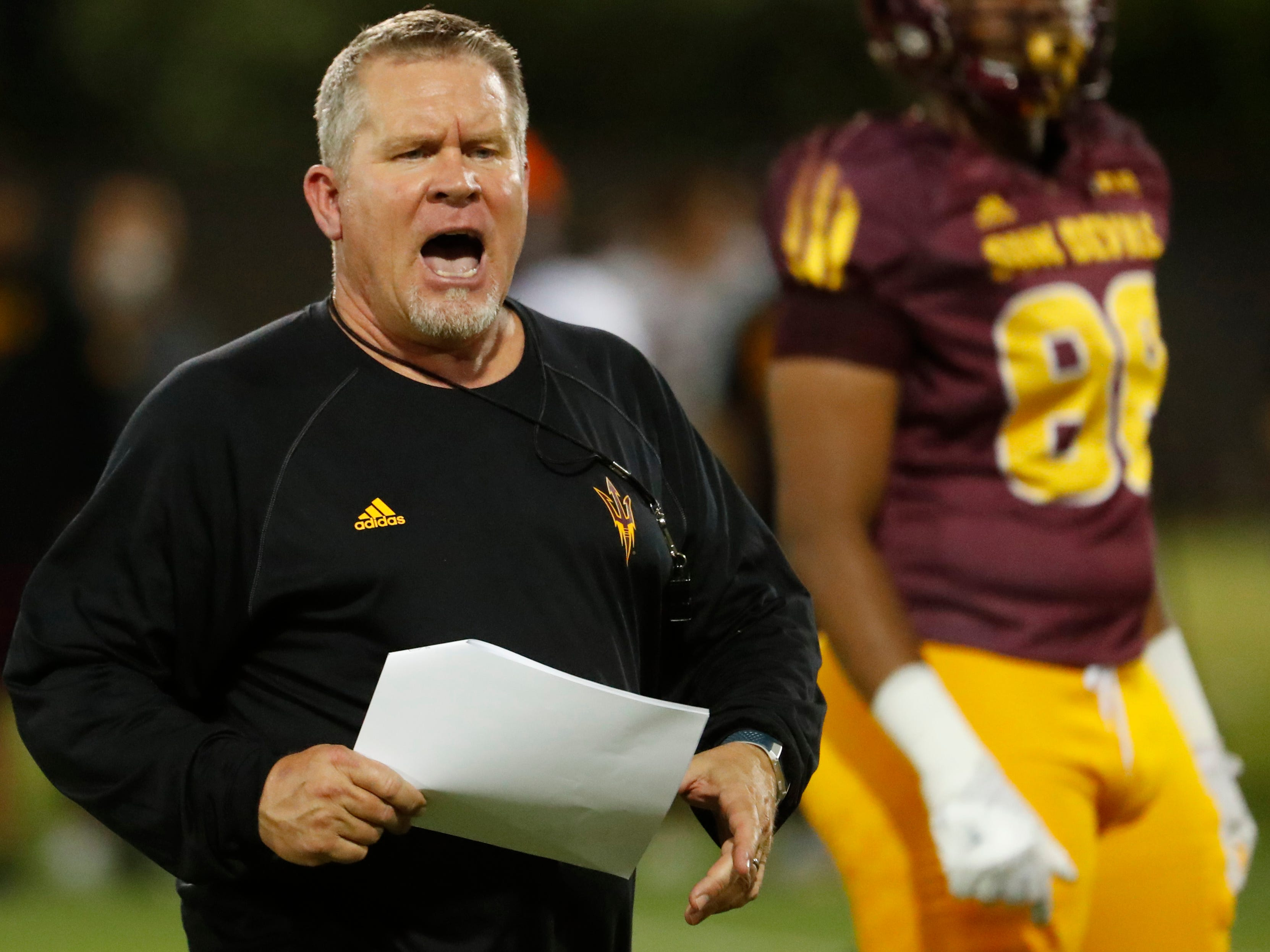 ASU's special teams coordinator Shawn Slocum talks to players during the ASU scrimmage at Kajikawa Practice Fields in Tempe, Ariz. on Aug. 11, 2018.