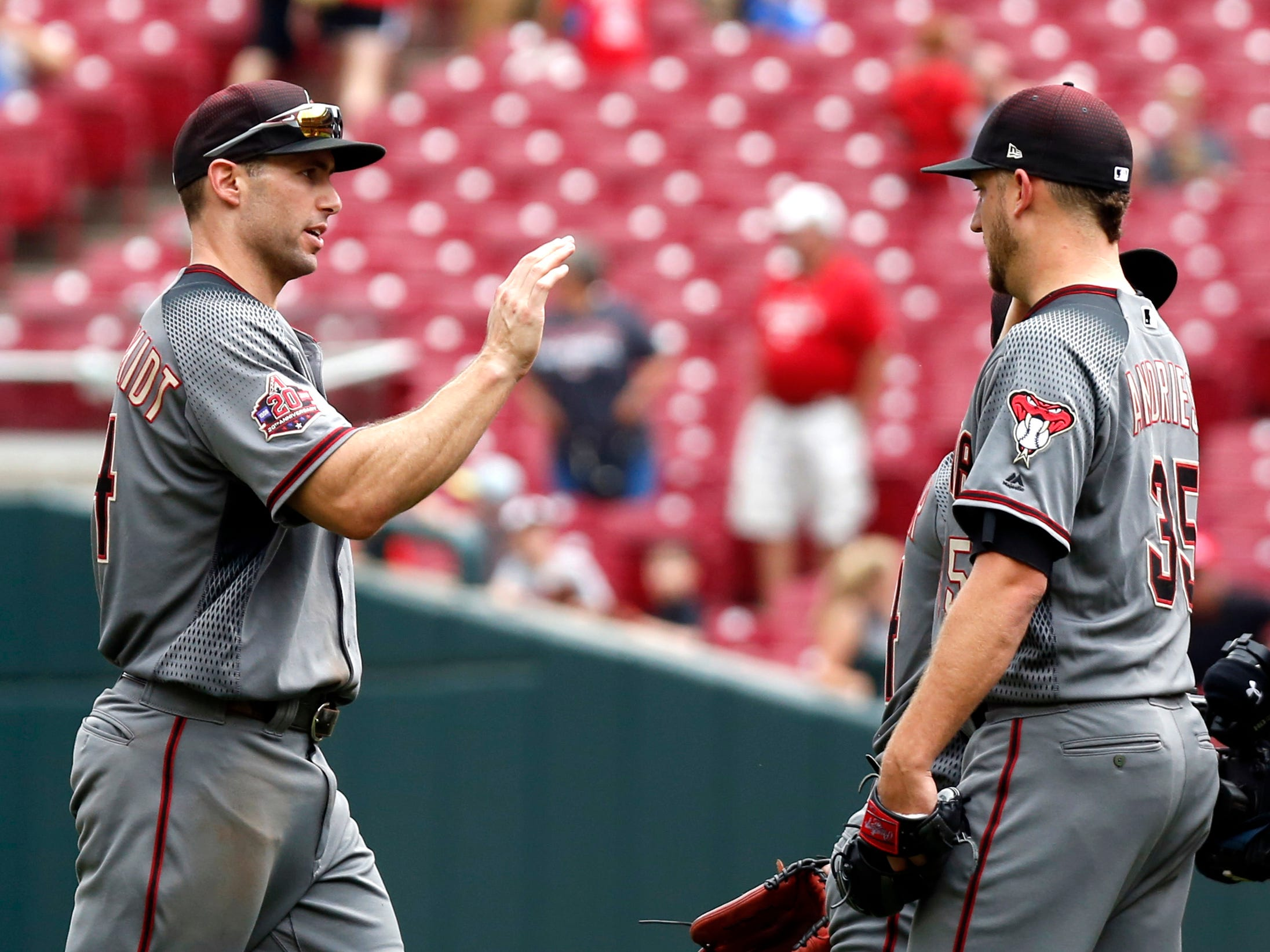 Aug 12, 2018; Cincinnati, OH, USA; Arizona Diamondbacks first baseman Paul Goldschmidt (44) and relief pitcher Matt Andriese (35) react after the Diamondbacks defeated the Cincinnati Reds at Great American Ball Park. Mandatory Credit: David Kohl-USA TODAY Sports